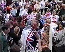 A still from [Ightham Coxcombe Fair Jubilee Celebration] (2002) - the crowd at the fair