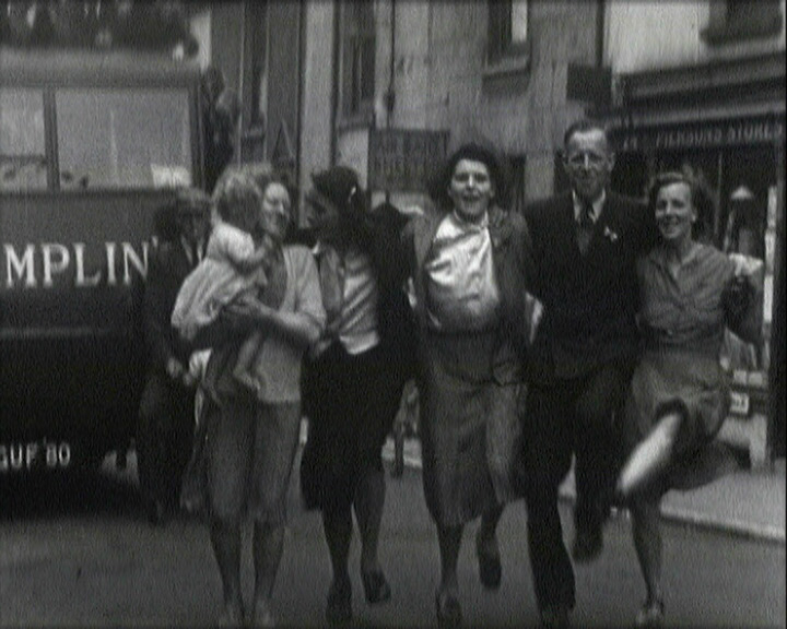 A still from [VE Day Celebrations in Brighton] (1945) - people dancing in the street