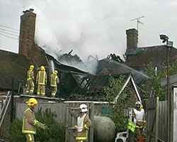 A still from 'Mid Sussex Newsreel' 2003 showing a fire at The Crown Inn at Horsted Keynes