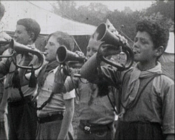 A still from [Scouts and Pulorough Outings] (1934) - Scouts playing bugles