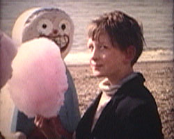 A still from [Brighton Pictures II] (1964-1965?) showing A boy with candy floss