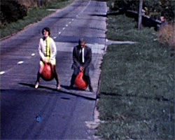 A Still from Brighton Cocktail (1969) showing two people on 'space hoppers'