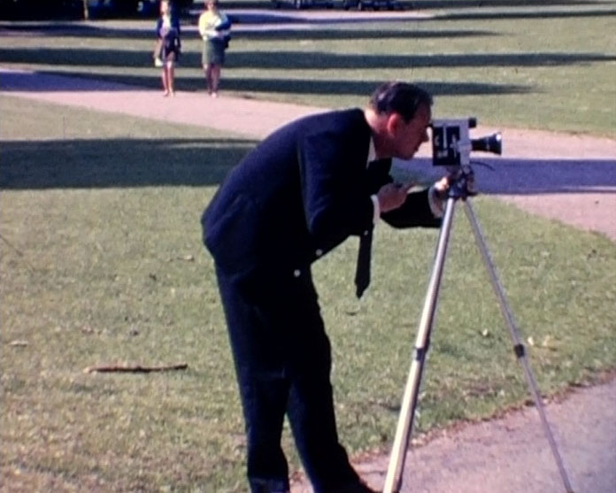 A Still from Brighton Cocktail (1969) showing a man with a cine camera