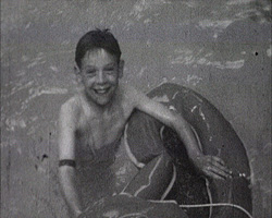 A still from [Sports Stadium. Opening of the SS Brighton Swimming Pool] (1934) - boy swimming