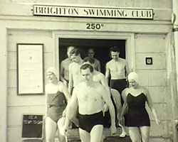 A still from [Brighton Swimming Club - Seaside Birthday] (1953) showing Ernie Trory and Brighton Swimming Club members