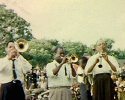 A still from [Our Wedding in East Africa; Ghana; Louis Armstrong Concert]  (1955-1956)