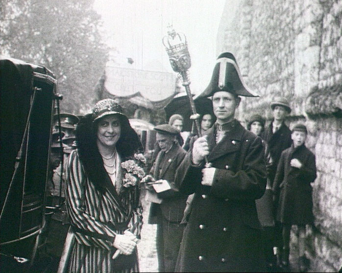 A still from Procession Gazette (ca.1930) showing people at the procession