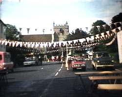 A still from 'Jubilee Wye 1977' - A street with bunting