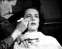 A still from '[Face Make-Up]' (ca.1947) showing make-up being applied
