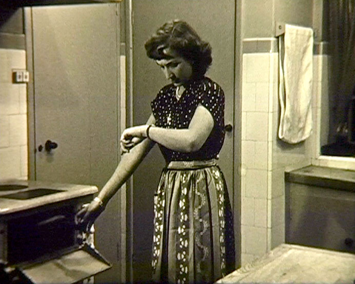 A still from 'Mrs Newlywed's First Dinner' (1940s) showing a woman in the kitchen