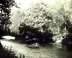 A still from 'Watery Trail - River Medway' (1938) - showing a small boat on the river