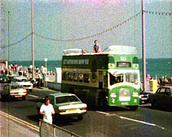 a still from 'Journey by Open Top Bus' (1985)