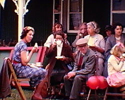 A Still from 'Birling, my Parish' (1964) - a group of people having tea