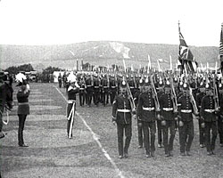 A still from 'The Marchioness Camden Presents New Colors to Special Reserves at Shorncliffe' (1913) showing troops marching