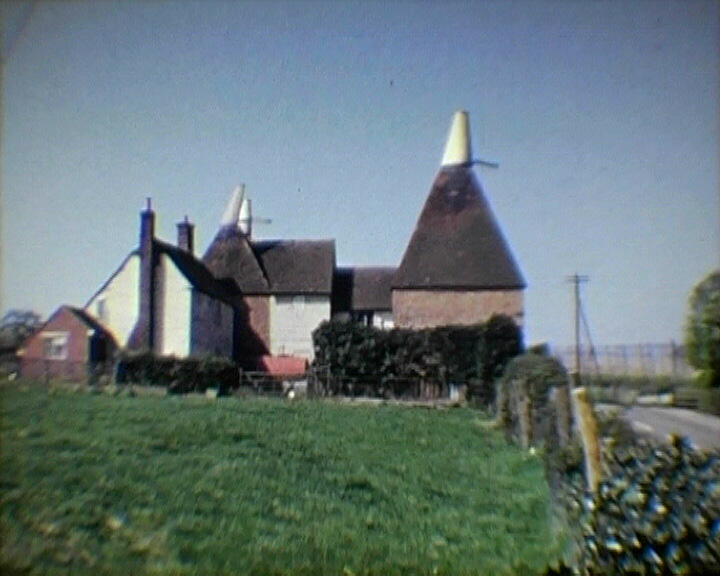 A Still from [Scenes of Kent Life. Ashford Carnival Week] (1957-1967) showing a Kent oast house